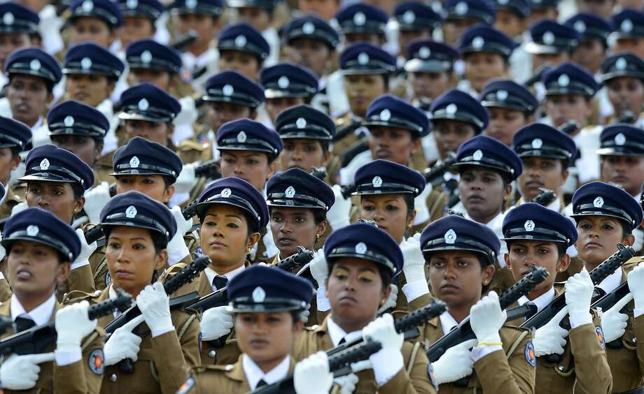 """TOPSHOTS Sri Lankan policewomen march during a Victory Day parade in the southern town of Matara on May 18, 2014. The government is holding a military """"victory parade"""" to mark five years since the defeat of Tamil Tiger rebels, who waged a decades-long battle for a separate homeland for minority Tamils. Services have been banned to honour Tamil rebels and remember civilians killed in the conflict which ended in 2009 after claiming at least 100,000 lives. AFP PHOTO/LAKRUWAN WANNIARACHCHILAKRUWAN WANNIARACHCHI/AFP/Getty Images Photo: Lakruwan Wanniarachchi, AFP/Getty Images"""