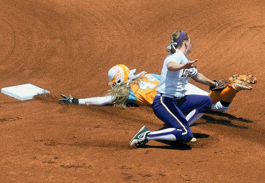 Lipscomb University's Bridgette Begle tags the leg of Tennessee's Madison Shipman attempting to steal second base in Tennessee's 2-0 shutout the NCAA Regional Final win Sunday, May 18, 2014, at Sherri Parker Lee in Knoxville, Tenn.  (AP Photo/The Daily Times, Tome Sherlin) Photo: Tom Sherlin, Associated Press