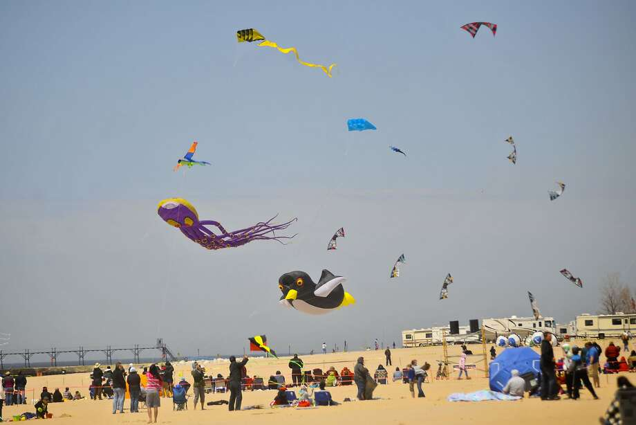 Hundreds of kites are flown during the 26th annual Great Lakes Kite Festival at the Grand Haven State Park, Mich., on Sunday, May 18, 2014. (AP Photo/The Muskegon Chronicle, Madelyn Hastings) Photo: Madelyn Hastings, Associated Press