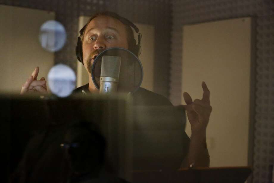 Voicing the part of a barbarian, voice over actor Adam Harrington makes up a gibberish language for a new mobile roll playing game at Kabam in San Francisco. Photo: Mike Kepka, The Chronicle