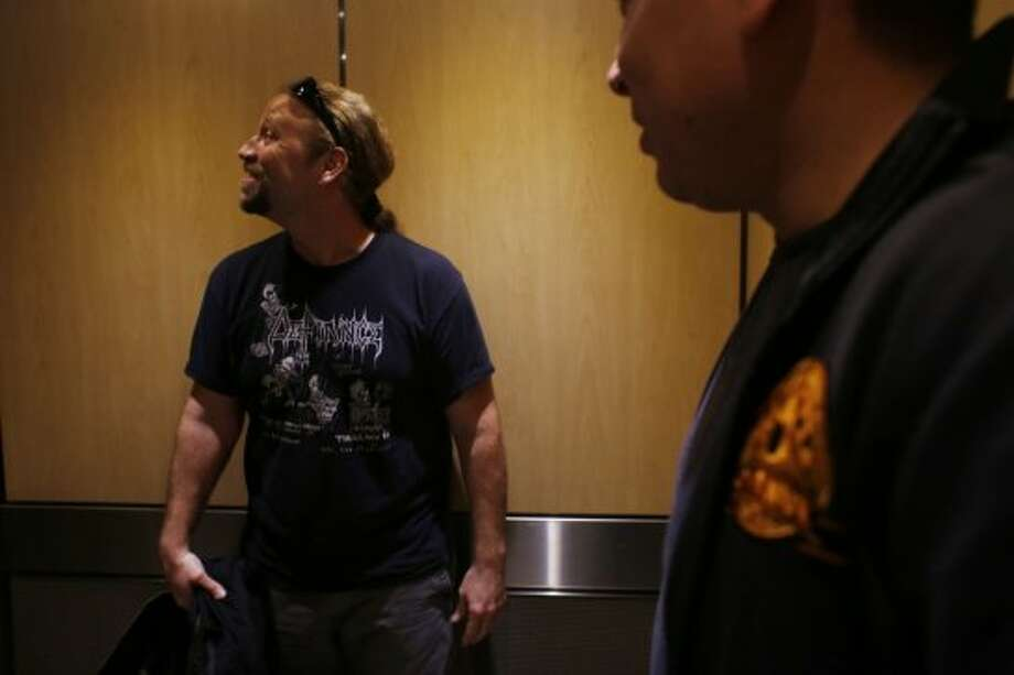 Voice over actor Adam Harrington pumps himself up in the elevator before recording at Kabam in San Francisco. Photo: The Chronicle
