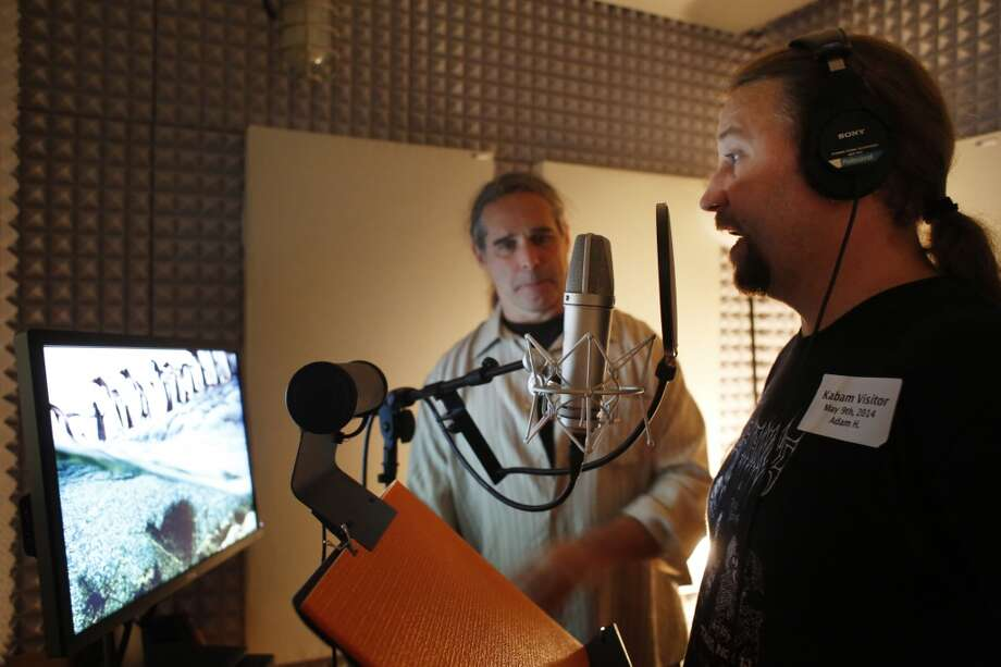 Voice over actor Adam Harrington receives instruction from senior sound designer Jerry Marting before making up a gibberish language for a new mobile roll playing game at Kabam in San Francisco. Photo: Mike Kepka, The Chronicle