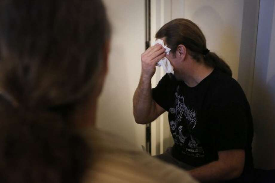 Voice over actor Adam Harrington wipes sweat from his brow after a completed recording session at Kabam in San Francisco. Photo: Mike Kepka, The Chronicle