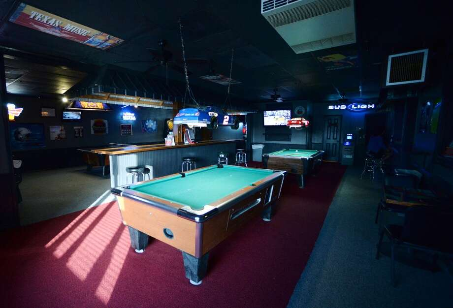 A pair of pool tables sit in one section of The West on Tuesday afternoon. The newly reopened The West Bar and Grill on Calder Avenue is the CAT5 Bar of the Week for April 15, 2014. Photo taken Tuesday, 5/6/14 Jake Daniels/@JakeD_in_SETX