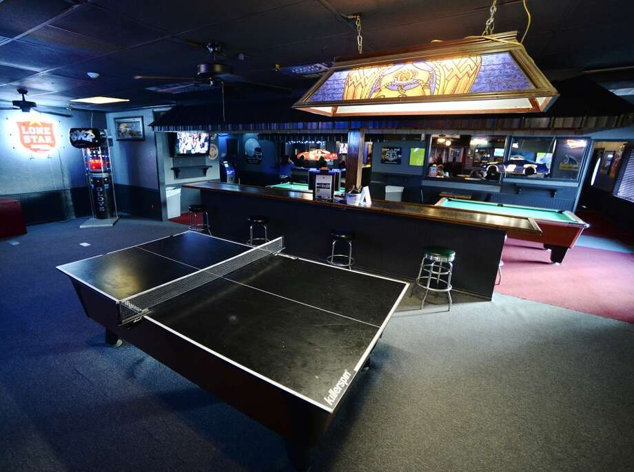 A ping pong tabletop sits on a pool table at The West on Tuesday afternoon. The newly reopened The West Bar and Grill on Calder Avenue is the CAT5 Bar of the Week for April 15, 2014. Photo taken Tuesday, 5/6/14 Jake Daniels/@JakeD_in_SETX