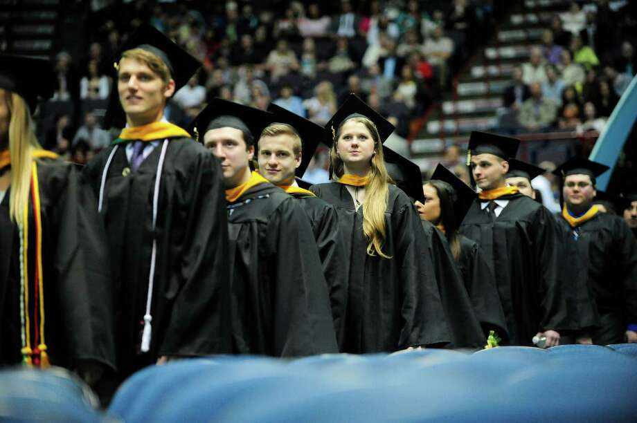 Graduates process in at the start of the Siena College Commencement at the Times Union Center on Sunday, May 18, 2014, in Albany, N.Y.  Siena awarded 758 Bachelor's and 54 Master of Science in Accounting degrees on Sunday.  (Paul Buckowski / Times Union) Photo: Paul Buckowski / 00026788A