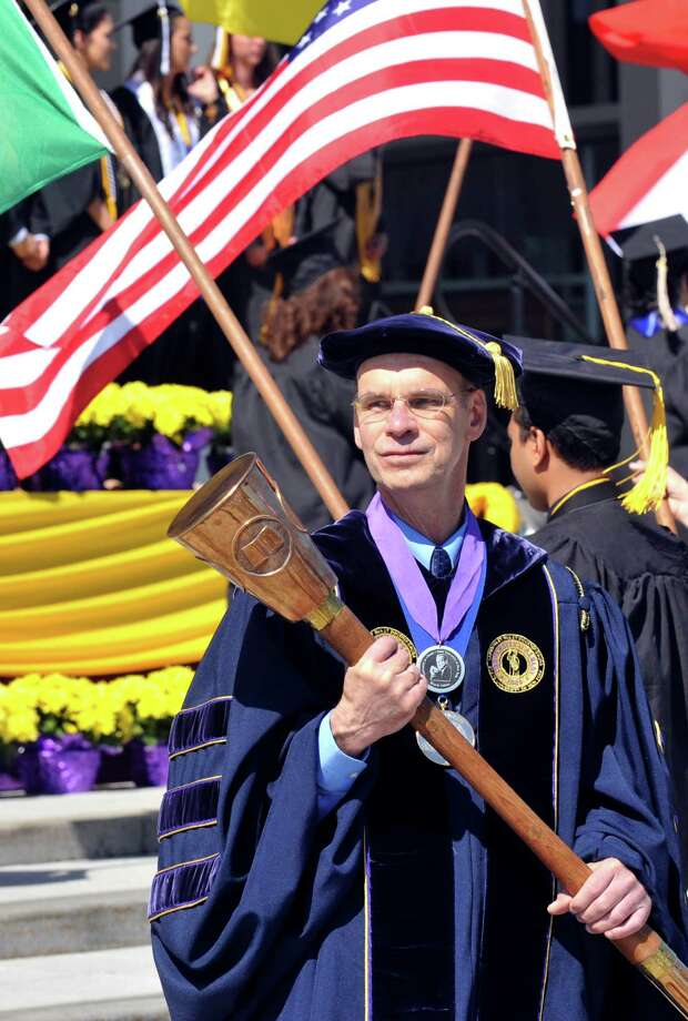 Grand Marshal David P. McCaffrey leads the University at Albany undergraduate commencement exercises in Albany, N.Y., Sunday, May 18, 2014. (Hans Pennink / Special to the Times Union) ORG XMIT: HP Photo: Hans Pennink / Hans Pennink