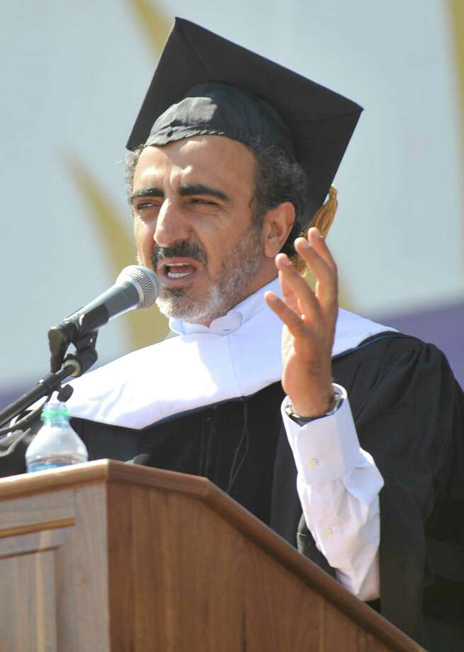 University at Albany commencement speaker Hamdi Ulukaya, Founder & CEO of Chobani, during the undergraduate commencement exercises in Albany, N.Y., Sunday, May 18, 2014. (Hans Pennink / Special to the Times Union) Photo: Hans Pennink / Hans Pennink