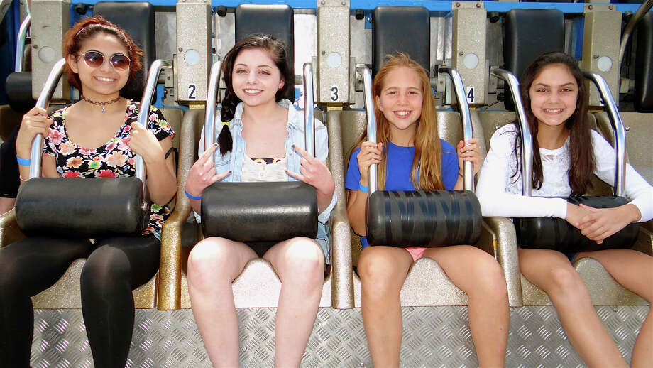 Sam Rodriguez, 15, of Bridgeport, shares a ride Sunday on Ali Baba with Fairfielders Savannah Behboudi, 16; Charlotte Robins, 11, and Mia Maniscalco, 11, at Holy Family Parish's Carnival at Jennings Beach. Photo: Mike Lauterborn / Fairfield Citizen