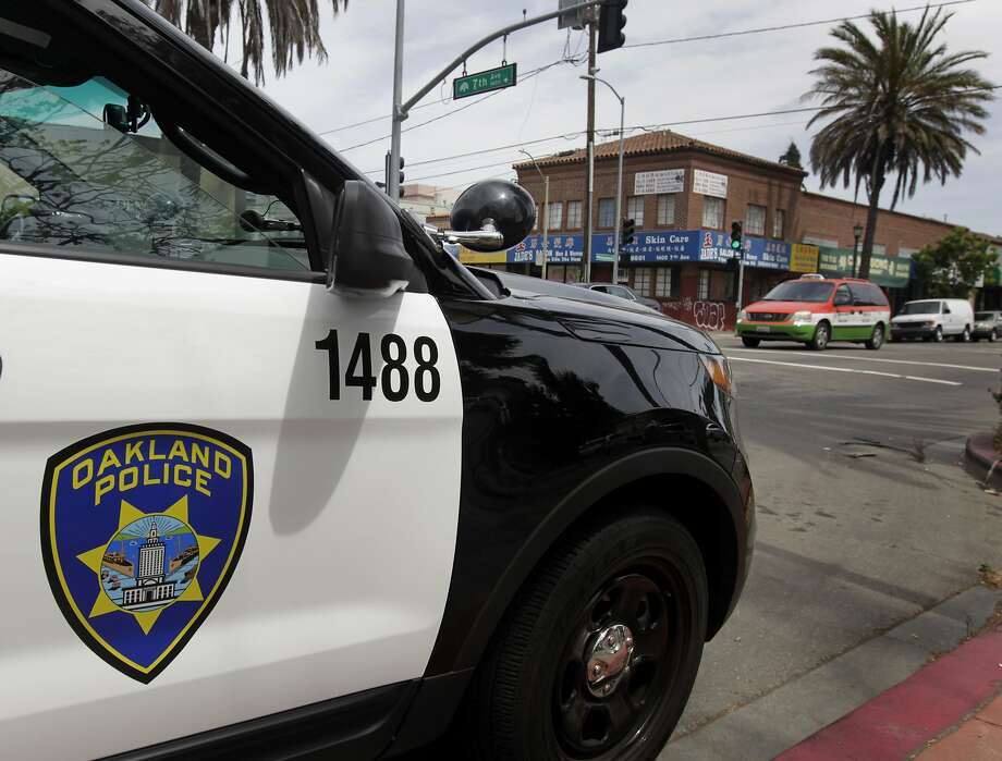 A police vehicle is parked at 7th Avenue and International Boulevard in the Eastlake neighborhood of Oakland, Calif. on Saturday, May 17, 2014. Photo: Paul Chinn, The Chronicle