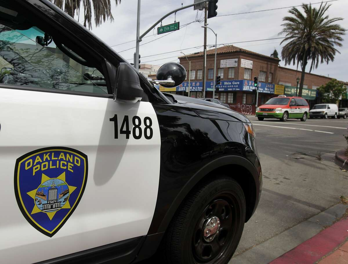 A police vehicle is parked at 7th Avenue and International Boulevard in the Eastlake neighborhood of Oakland, Calif. on Saturday, May 17, 2014.