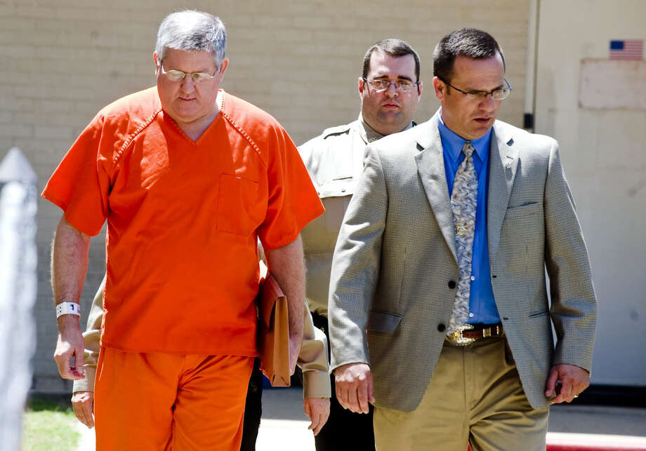"FILE - In a Tuesday May 6, 2014 file photo, Bernie Tiede is escorted into the Panola County Courthouse, in Carthage, Texas. Three of the jurors who gave Tiede a life sentence for killing 81-year-old Marjorie Nugent say they're not happy he's being released early. The jurors spoke to the Longview News-Journal days after Tiede was let out of prison for the murder of Nugent. Tiede was released on bond on May 6, 2014 after the district attorney who prosecuted him agreed to let him out of a life sentence.  The killing and the reaction of the town of Carthage were profiled in the 2011 movie ""Bernie,"" which drew new attention to the case. (AP Photo/The News-Journal, Michael Cavazos, File) Photo: Michael Cavazos, MBR / The News-Journal"