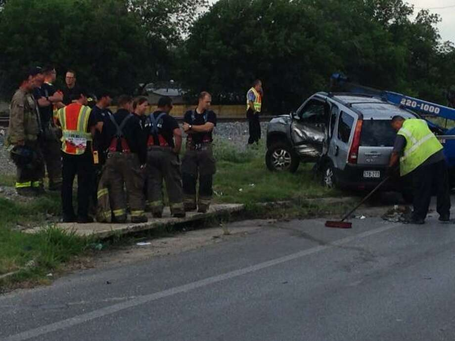 A car crash on the East Side sent an SUV into the path of an oncoming train Monday morning. Photo: Alia Malik/San Antonio Express-News
