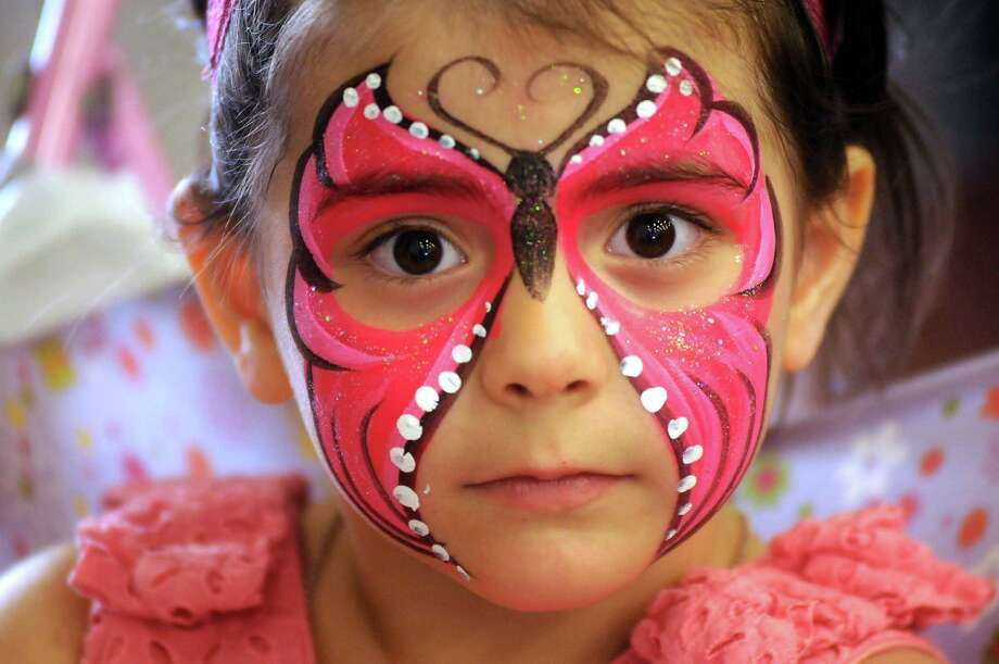 Briseis Buitron with a decorated face at the Pasadena Strawberry Festival Sunday May 18, 2014.(Dave Rossman photo) Photo: Dave Rossman, For The Houston Chronicle / © 2014 Dave Rossman
