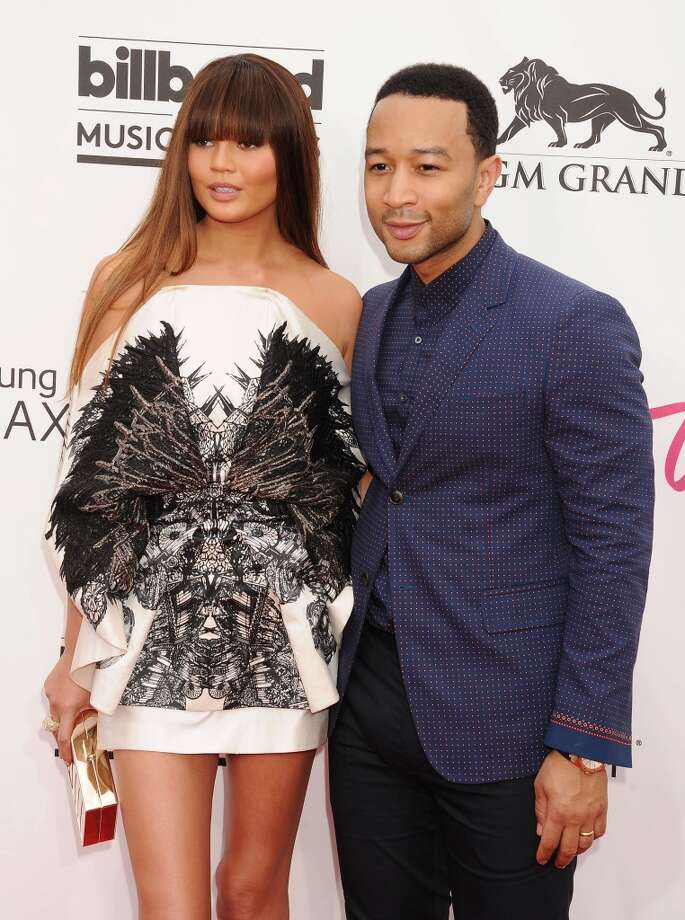 Model Christine Teigen (L) and musician John Legend arrive at the 2014 Billboard Music Awards at the MGM Grand Garden Arena on May 18, 2014 in Las Vegas, Nevada. Photo: Jeffrey Mayer, WireImage