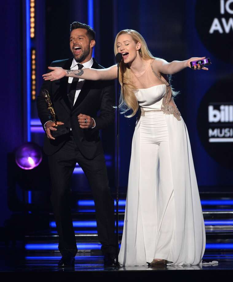 Singers Ricky Martin (L) and Iggy Azalea speak onstage during the 2014 Billboard Music Awards at the MGM Grand Garden Arena on May 18, 2014 in Las Vegas, Nevada. Photo: Ethan Miller, Getty Images