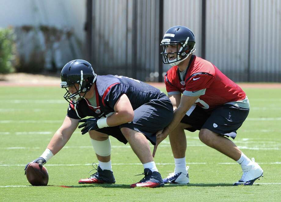 Houston Texans quarterback draft pick Tom Savage, right, takes a snap from James Ferentz during a rookie football mini-camp Friday, May 16, 2014, in Houston. (AP Photo/Pat Sullivan) Photo: Pat Sullivan, Associated Press / AP