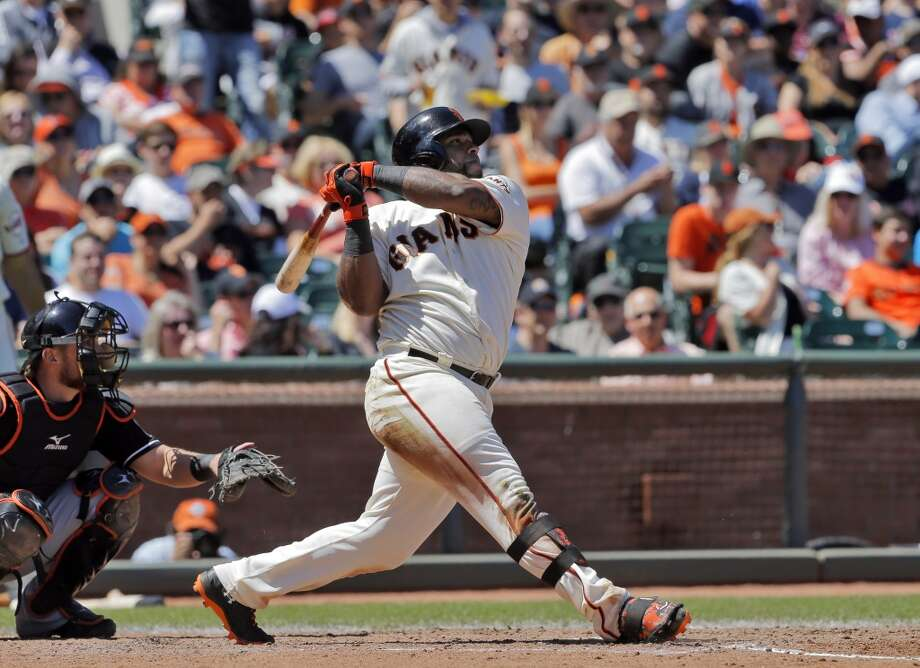 Pablo Sandoval watches his solo homerun go over the left-center wall in the fifth inning. The San Francisco Giants played the Miami Marlins at AT&T Park in San Francisco, Calif., on Sunday, May 18, 2014. The Giants won 4-1. Photo: The Chronicle