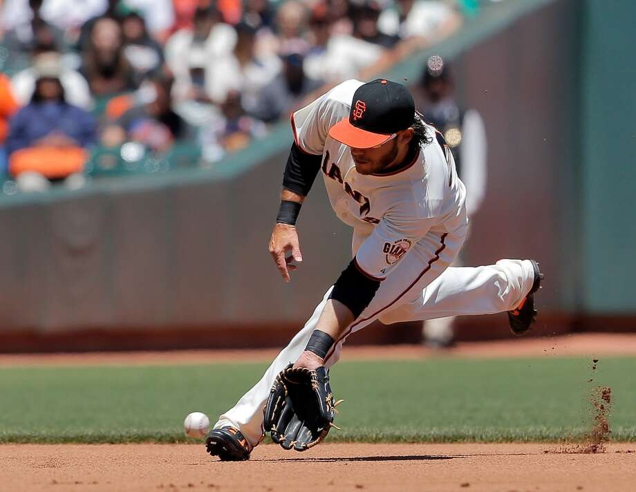 Brandon Crawford makes a play on a ball hit in the infield against the Marlins on Sunday. The San Francisco Giants played the Miami Marlins at AT&T Park in San Francisco, Calif., on Sunday, May 18, 2014. The Giants won 4-1. Photo: The Chronicle