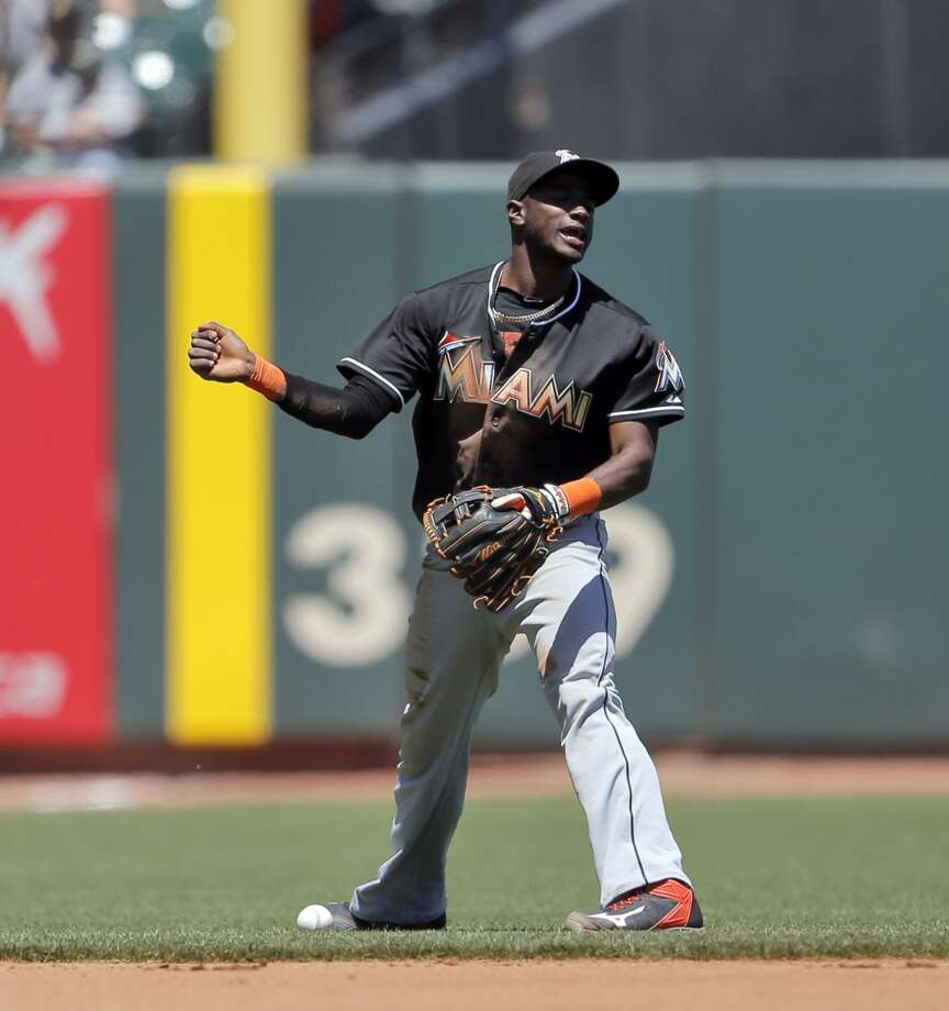 Marlin's shortstop Adeiny Hechavarria reacts to failing to complete the play on an infield hit by Ryan Vogelsong in the second inning. The San Francisco Giants played the Miami Marlins at AT&T Park in San Francisco, Calif., on Sunday, May 18, 2014. The Giants won 4-1. Photo: The Chronicle