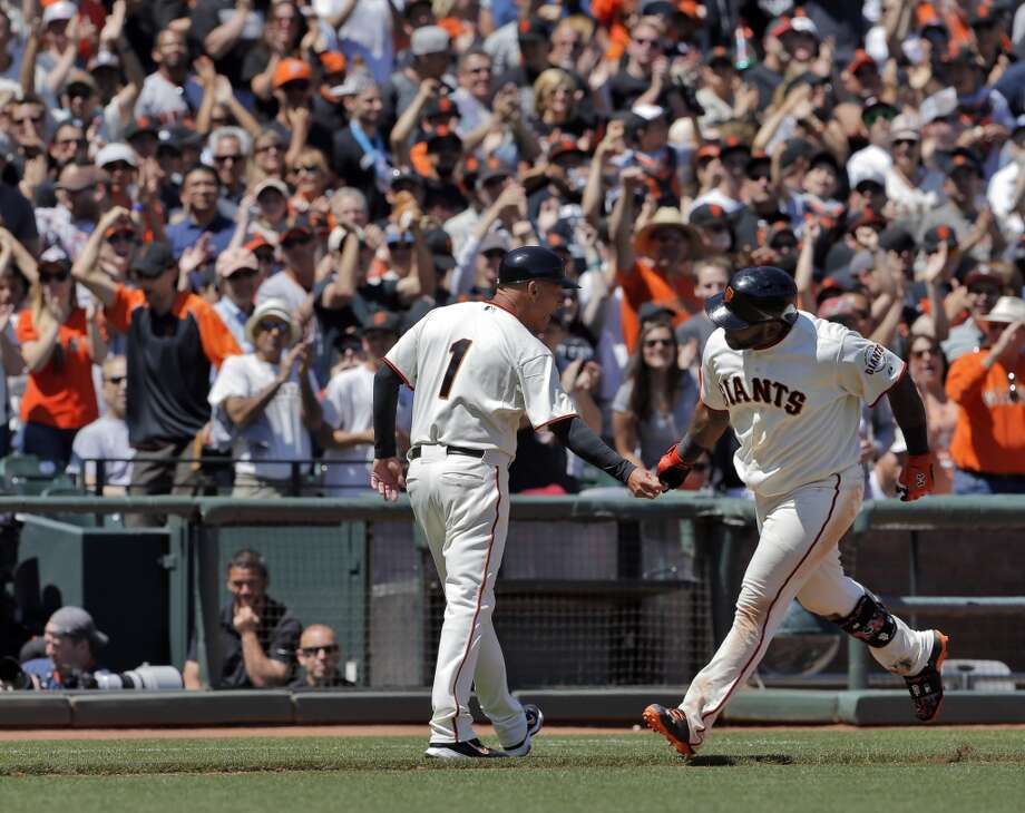 Pablo Sandoval (48) is congratulated by third base coach Tim Flannery after Sandoval hit a solo homerun in the fifth inning. The San Francisco Giants played the Miami Marlins at AT&T Park in San Francisco, Calif., on Sunday, May 18, 2014. The Giants won 4-1. Photo: The Chronicle