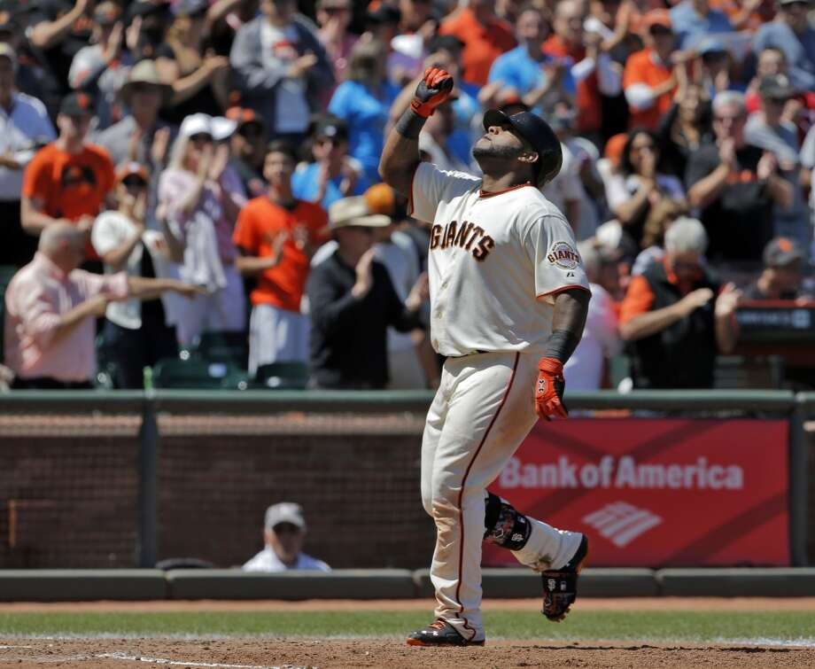 Pablo Sandoval (48) points up after crossing home plate after he hit a solo homerun in the fifth inning. The San Francisco Giants played the Miami Marlins at AT&T Park in San Francisco, Calif., on Sunday, May 18, 2014. The Giants won 4-1. Photo: The Chronicle