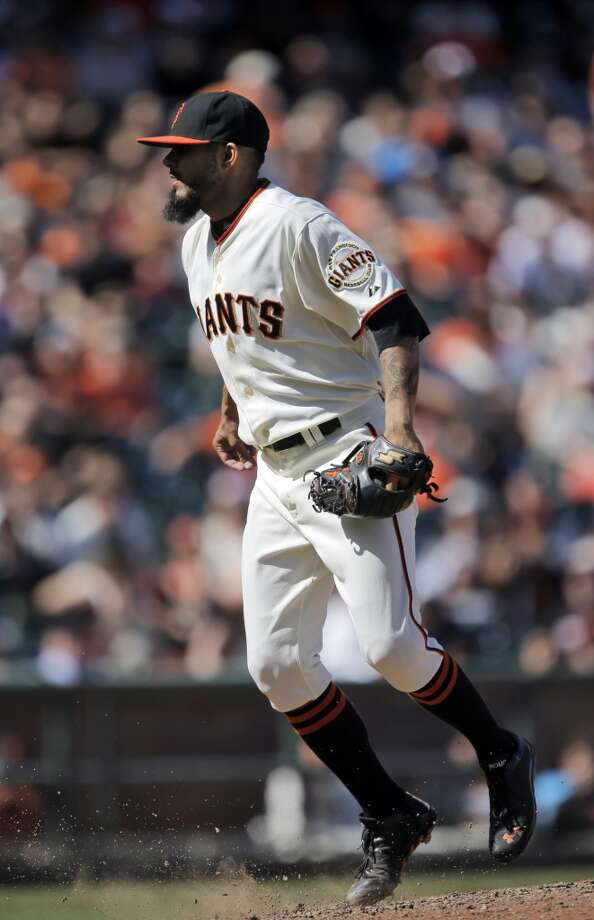 Sergio Romo (54) hops after following through on his pitch in the ninth. The San Francisco Giants played the Miami Marlins at AT&T Park in San Francisco, Calif., on Sunday, May 18, 2014. The Giants won 4-1. Photo: The Chronicle