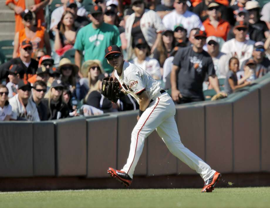 Tyler Colvin throws back to the infield in the ninth inning. The San Francisco Giants played the Miami Marlins at AT&T Park in San Francisco, Calif., on Sunday, May 18, 2014. The Giants won 4-1. Photo: The Chronicle