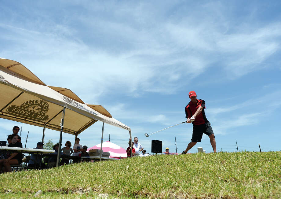 Dave Romain from Houston tries out his swing at the Border Bash event on Saturday. Several dozen competitors tried their golf swing at Border Bash: Long-Drive Golf at Orange's Riverfront Boardwalk on Saturday. The event, which was organized with the hope of drawing the Long Drivers of America tour to the area, had golfers attempting to drive balls from the Orange, Texas, park into Louisiana over the Sabine River. The tour will be looking for corporate sponsorship and civic support, said Shane Johns. Golfers teed off from a tee box that was built by the city specifically for the competition. A shoot out for $500 between the top drivers of the morning and afternoon sessions was planned for later Saturday afternoon. Photo taken Saturday 5/17/14 Jake Daniels/@JakeD_in_SETX Photo: Jake Daniels / ©2014 The Beaumont Enterprise/Jake Daniels