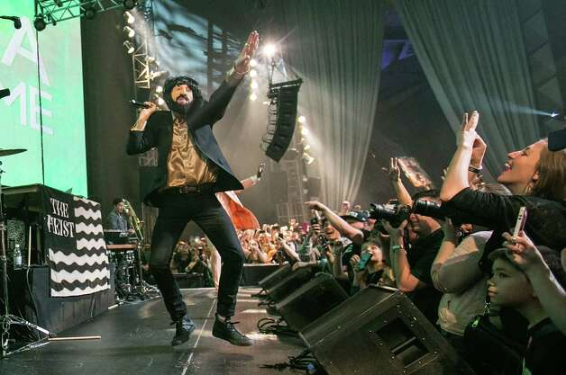 """A costumed Macklemore performs at the opening night of """"Spectacle: The Music Video"""" exhibition at EMP Museum on May 16, 2014 in Seattle. Photo: Suzi Pratt, FilmMagic / 2014 Suzi Pratt"""