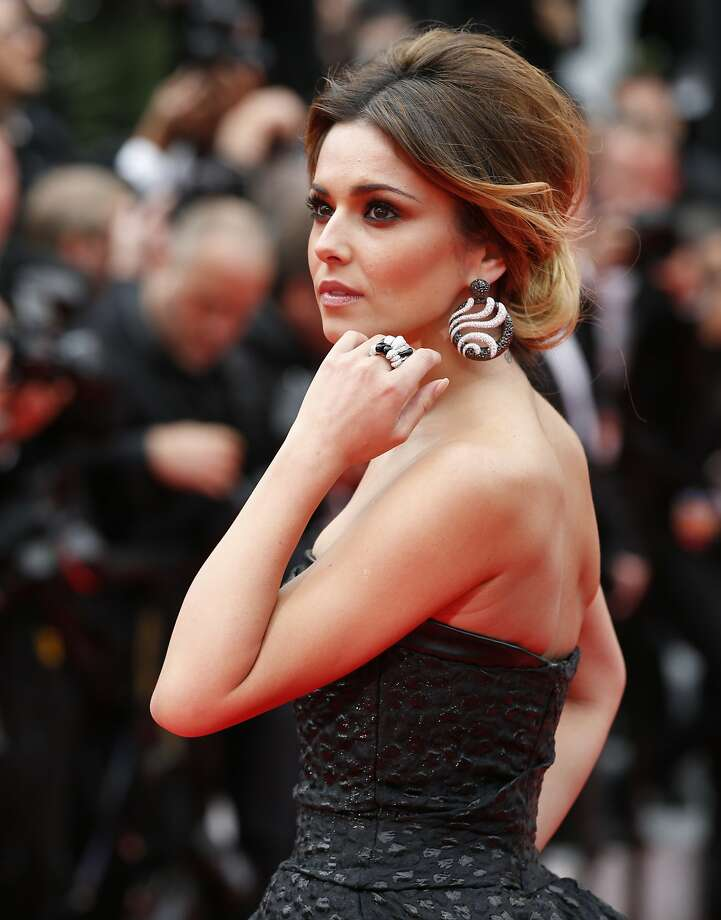 Performer Cheryl Cole poses for photographers as she arrives for the screening of Foxcatcher at the 67th international film festival, Cannes, southern France, Monday, May 19, 2014. Photo: Alastair Grant, Associated Press