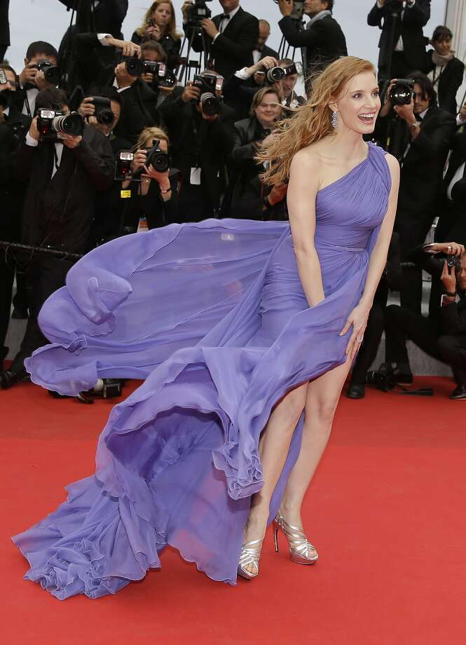 Actress Jessica Chastain holds down her dress as she poses for photographers as she arrives for the screening of Foxcatcher at the 67th international film festival, Cannes, southern France, Monday, May 19, 2014.  Photo: Thibault Camus, Associated Press