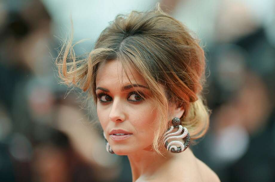 Cheryl Cole - Her earrings are incredible.  Photo: Pascal Le Segretain, Getty Images