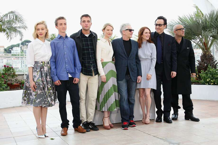 """(L-R) Actors Sarah Gadon, Evan Bird, Robert Pattinson, Mia Wasikowska, director David Cronenberg, actors Julianne Moore, John Cusack and Bruce Wagner attend the """"Maps To The Stars"""" photocall during the 67th Annual Cannes Film Festival on May 19, 2014 in Cannes, France.  Photo: Vittorio Zunino Celotto, Getty Images"""