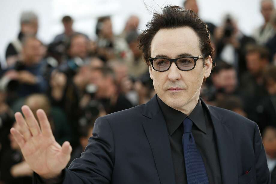 Actor John Cusack poses for photographers during a photo call for Maps to the Stars at the 67th international film festival, Cannes, southern France, Monday, May 19, 2014.  Photo: Alastair Grant, Associated Press
