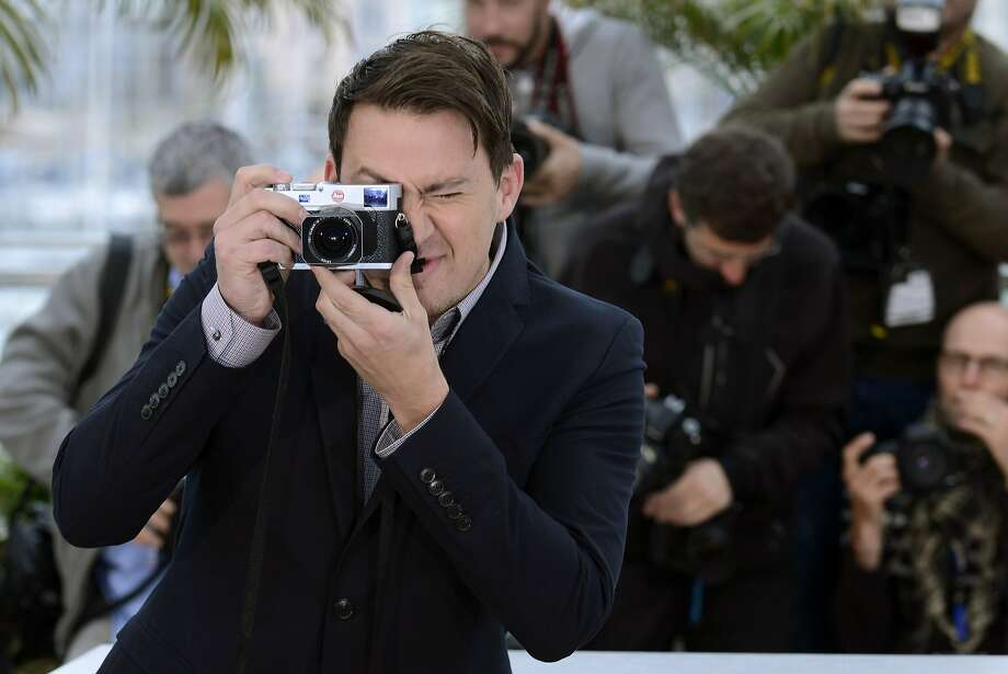 Actor Channing Tatum takes a photo during a photo call for Foxcatcher at the 67th international film festival, Cannes, southern France, Monday, May 19, 2014.  Photo: Arthur Mola, Associated Press