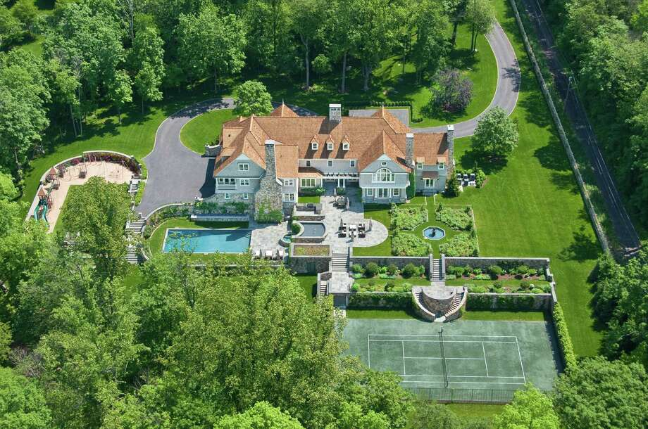 The English Arts and Crafts-style estate at 1248 Oenoke Ridge in New Canaan, located in one of the town's most desirable areas, was designed in 2005 by Wadia Associates. It is on the market for $10,500,000. Photo: Contributed Photo, Contributed / New Canaan News