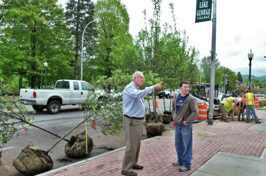 Lake George Village Myaor Robert Blais, left, and village street commissioner Ray Perry check out tree plantings on Canada Street in as part of the village's streetscape improvement project Wednesday afternoon May 18, 2011.   (John Carl D'Annibale / Times Union) ORG XMIT: MER2014051416555489 Photo: John Carl D'Annibale