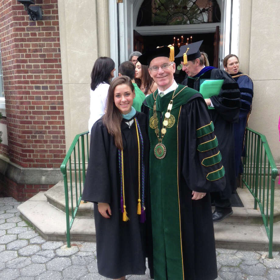 Valedictorian Kate Bowen, left, of Newtown, is seen here with Manhattan College President Brennan O'Donnell on graduation day. Photo: Contributed Photo / The News-Times Contributed