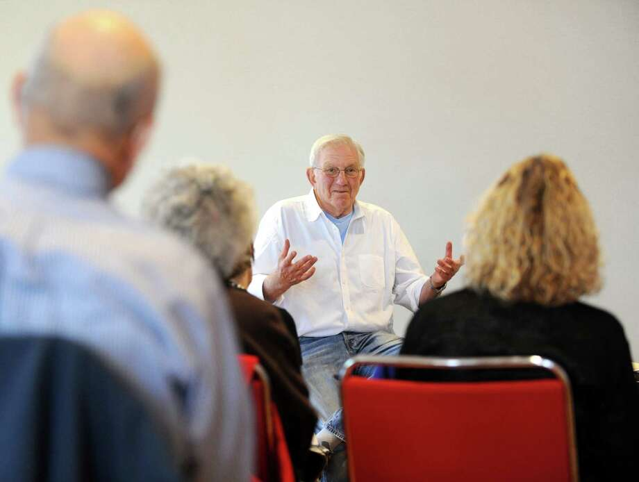 Bob Salomon, of Stamford, speaks at the second of a two-day financial literacy lecture at the YMCA of Greenwich, Conn. on Monday, May 19, 2014. Salomon used charts and data from the Wall Street Journal to explore topics like stocks, bonds, commodities and other investing tools to a crowd of about 16 people. Photo: Cathy Zuraw / Greenwich Time