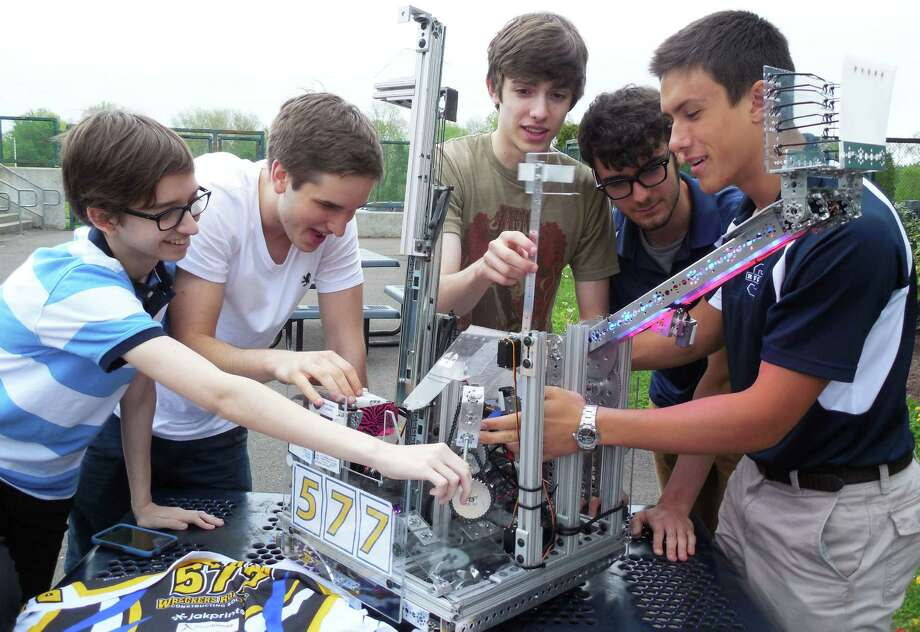 "Members of the Wreckers Robotics team at Staples High School with their robot ""Brick House."" Photo: Anne M. Amato / westport news"