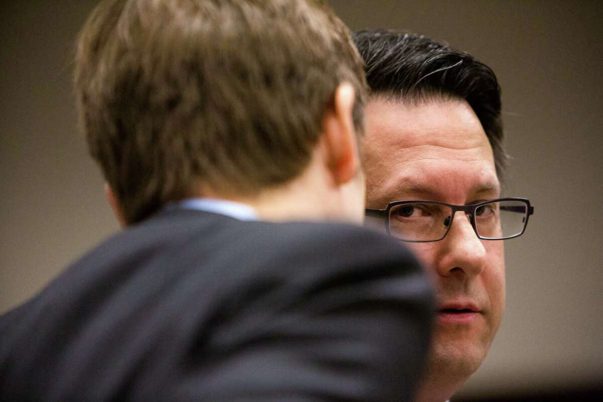 Former Seattle lawyer Danford Grant, right, was sentenced to 25 years in prison for raping multiple masseuses in the Seattle area Monday, May 19, 2014, in Seattle. The sentence - exceptionally high according to the state's sentencing recommendations for the crimes - had been agreed to ahead of the day's hearing.
