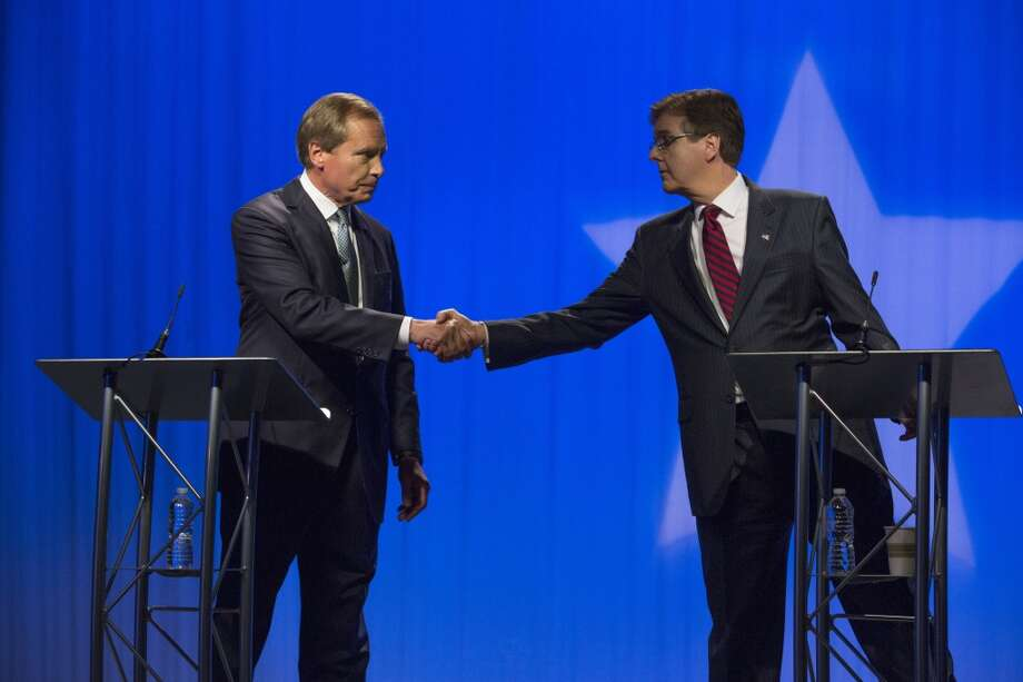 May 2, 2014: Lt. Gov. David Dewhurst, left, and Dan Patrick start their debate with a handshake at the Houston Public Media studios. Photo: Eric Kayne, ElcinorhC Eht RoF