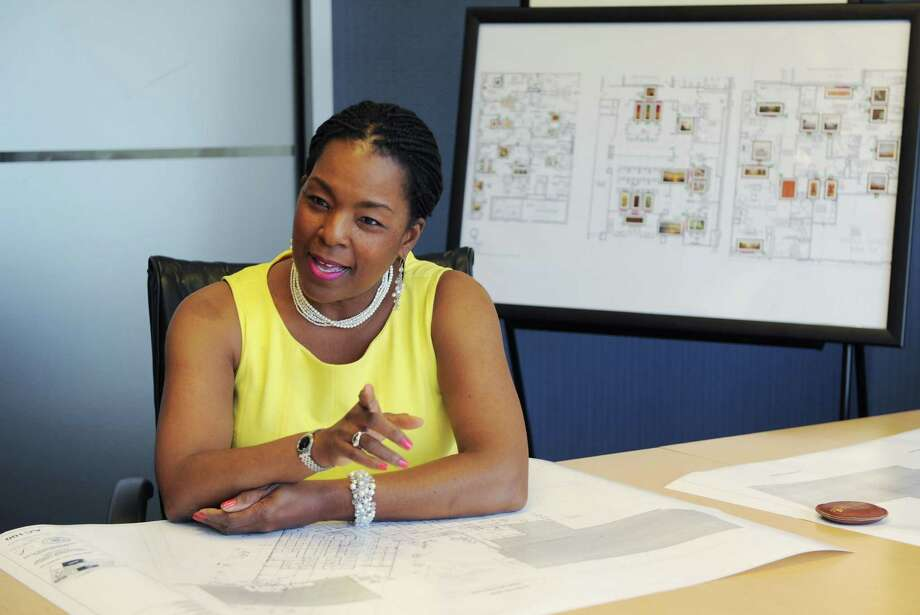 Valerie Cooper runs Picture That a corporate full-service art consulting firm in Stamford, Conn. She's pictured in her office on Monday May 19, 2014. Photo: Dru Nadler / Stamford Advocate Freelance