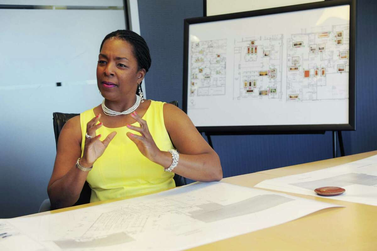 Valerie Cooper runs Picture That a corporate full-service art consulting firm in Stamford, Conn. She's pictured in her office on Monday May 19, 2014.