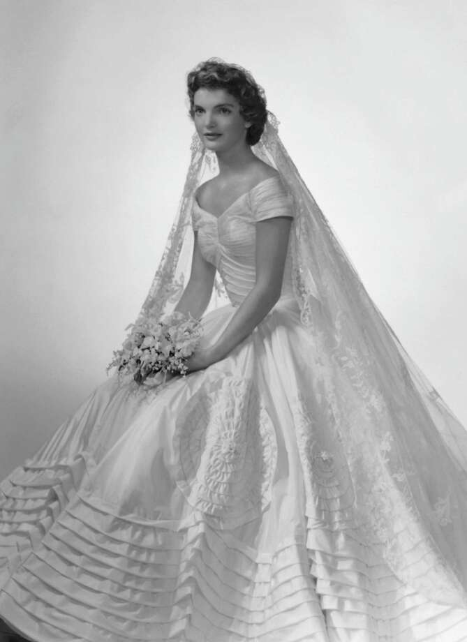 Bridal portrait of Jacqueline Lee Bouvier shows her in an Anne Lowe-designed wedding dress, 1953. Photo: Bachrach, Getty Images / Archive Photos