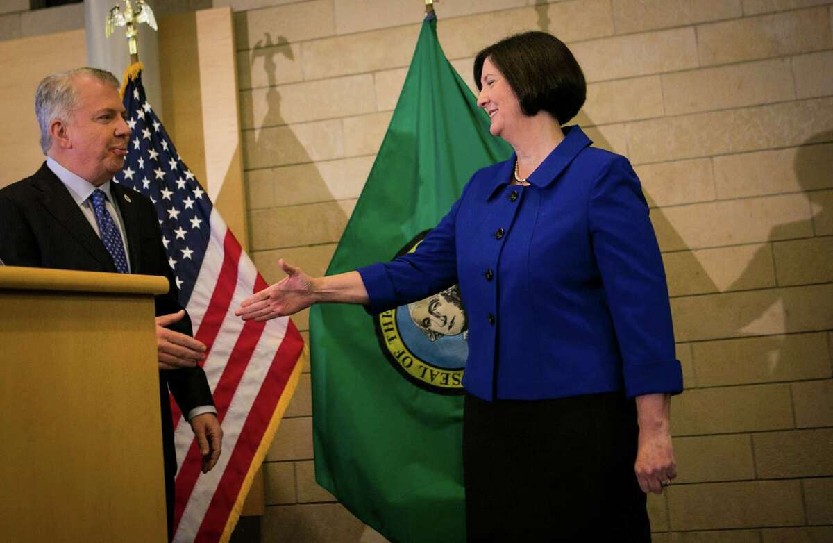 Seattle Mayor Ed Murray shakes the hand of former Boston Police Commissioner Kathleen O'Toole as Murray introduces O'Toole as his nominee for Seattle Police Chief. Photographed on Monday, May 19, 2014 at Seattle City Hall.