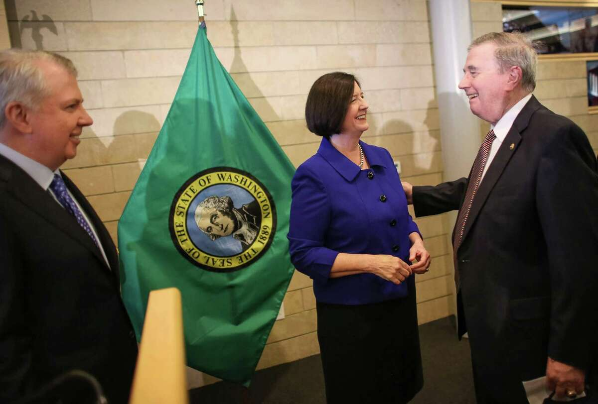 Seattle Mayor Ed Murray, left and former Boston Police Commissioner Kathleen O'Toole greet former Seattle Police Chief Patrick Fitzsimons after Murray introduced O'Toole as his nominee for Seattle Police Chief. Photographed on Monday, May 19, 2014 at Seattle City Hall.