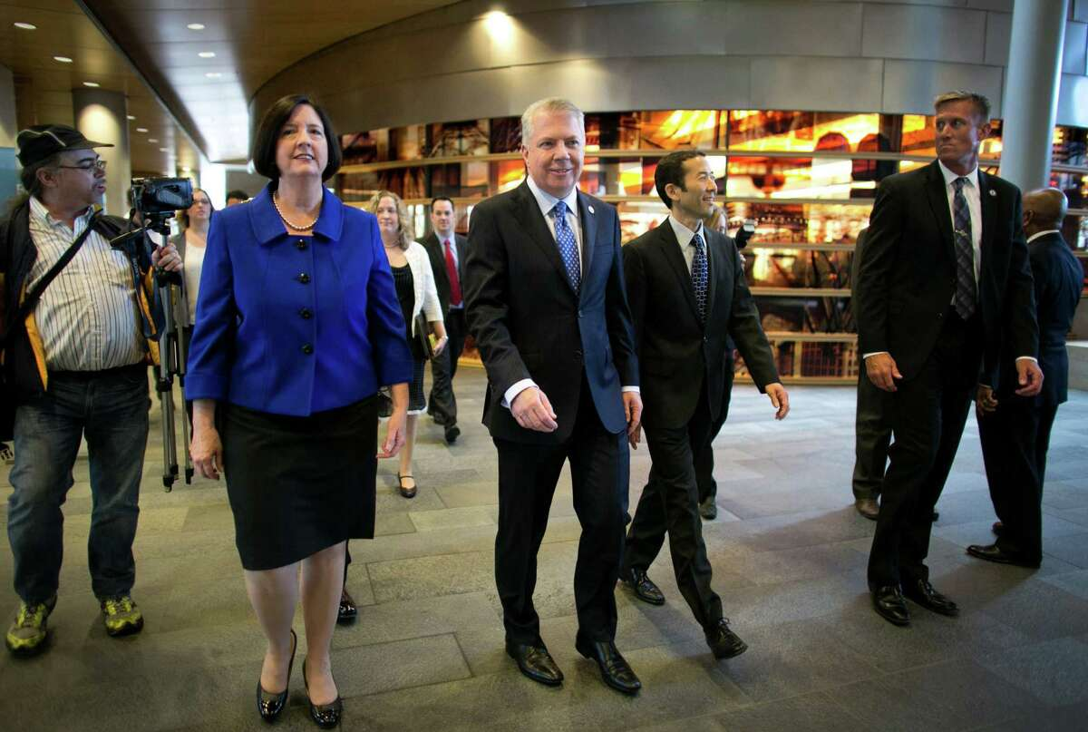 Seattle Mayor Ed Murray walks with former Boston Police Commissioner Kathleen O'Toole, left, after Murray introduced O'Toole as his nominee for Seattle Police Chief. Photographed on Monday, May 19, 2014 at Seattle City Hall.