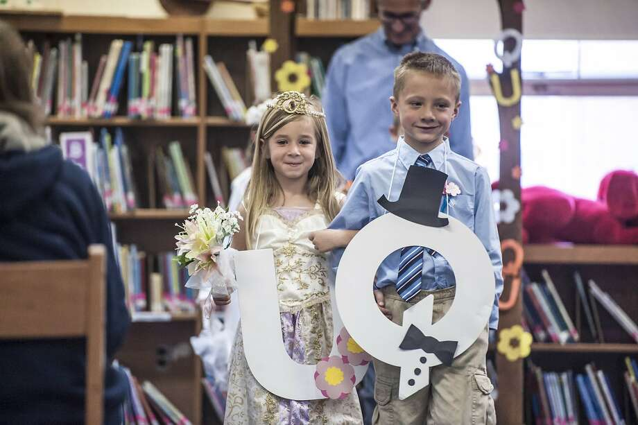 "We were meant for each other: ""Q"" and ""U"" are joined in holy grammatrimony in the library at Woodlawn Elementary School in Danville, Ky. Photo: Clay Jackson, Associated Press"